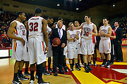 NCAA Men's Basketball: Surrounded by his players, VMI head coach Duggar Baucom holds the game ball at the conclusion of Saturday's 94-80 win by the Keydets over Longwood.  The victory, Baucom's 117th, made him the winningest coach in VMI history.