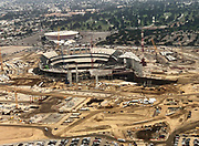 General overall aerial view of L.A. Stadium and Entertainment District at Hollywood Park under construction with the Forum in the background on Tuesday, Sept. 12, 2018 in Inglewood, Calif. The venue, privately financed by Los Angeles Rams owner Stan Kroenke, is scheduled to open in 2020. It will be the home to the Rams and the Los Angeles Chargers and will play host to Super Bowl LVI in 2022, 2023 College Football National Championship and the opening and closing ceremonies of the 2028 Olympics,