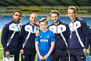 AFC Wimbledon midfielder Andy Barcham (17) , AFC Wimbledon defender Barry Fuller (2) , AFC Wimbledon defender Callum Kennedy (23) and AFC Wimbledon defender Paul Robinson (6) with mascot during the EFL Sky Bet League 1 match between Oxford United and AFC Wimbledon at the Kassam Stadium, Oxford, England on 7 October 2017. Photo by Simon Davies.
