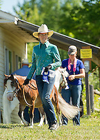 """Kiera Everson with her Mini horse """"Razzy"""" of Pittsfield receives a blue ribbon in the Fit and Show competition Saturday morning at the Belknap County 4H Fair in Belmont.  (Karen Bobotas/for the Laconia Daily Sun)"""
