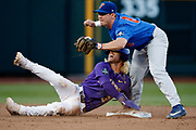 LSU's Kramer Robertson is caught stealing by Florida's Deacon Liput during the LSU vs. Florida baseball game on Monday, June 26, 2017 during game 1 of the Championship Series  of the College World Series at TD Ameritrade Park in Omaha.