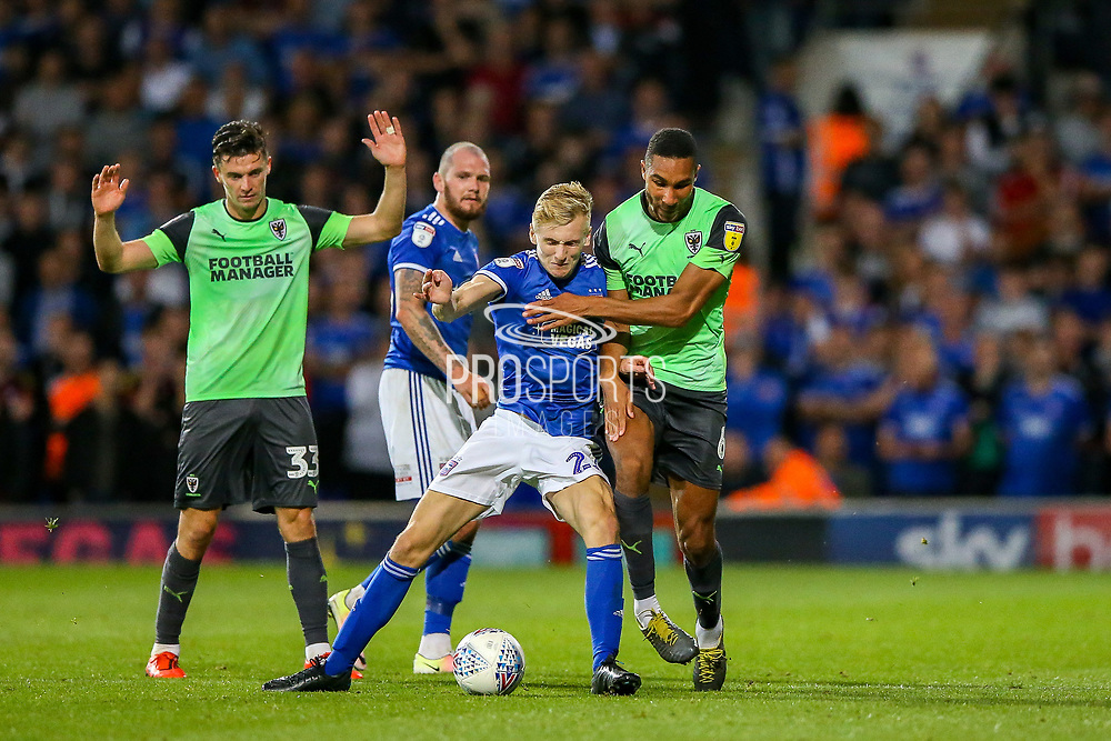 AFC Wimbledon defender Terell Thomas (6) tussles with Ipswich Town midfielder Flynn Downes (21) during the EFL Sky Bet League 1 match between Ipswich Town and AFC Wimbledon at Portman Road, Ipswich, England on 20 August 2019.