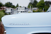A classic chevrolet car parked looking out into Newport Bay, Oregon