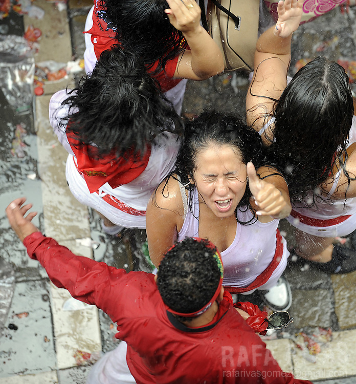 Participants are sprayed with water as they celebrate during the 'Chupinazo' to mark the start at noon sharp of the San Fermin Festival on July 6, 2012 in front of the Town Hall of Pamplona, northern Spain. Tens of thousands of people packed Pamplona's streets for a drunken kick-off to Spain's best-known fiesta: the nine-day San Fermin bull-running festival. PHOTO / Rafa Rivas