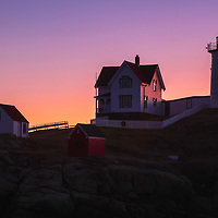 Nubble Lighthouse silhouette taken at dawn minutes before sunrise. Loved watching this sunrise and how the first light created a beautiful silhouette of Nubble Light. It's my favorite time of the day, when I can enjoy quietude and solitude.<br />
