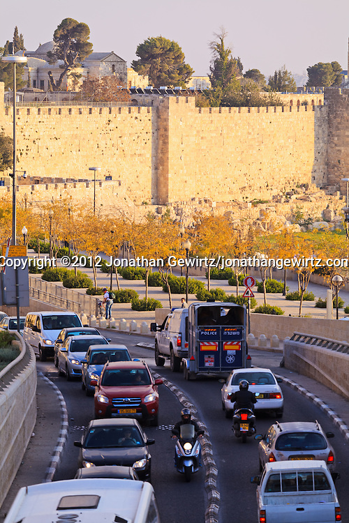 Heavy traffic on Jerusalem's Jaffa Street passes along the walls of the Old City of Jerusalem. WATERMARKS WILL NOT APPEAR ON PRINTS OR LICENSED IMAGES.