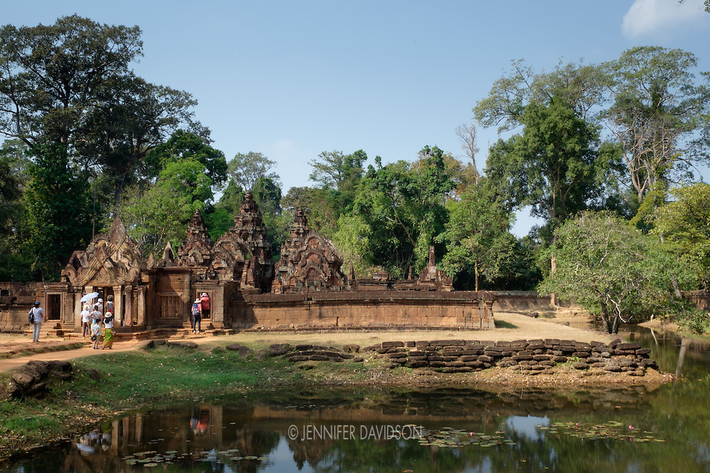 Banteay Srei, part of the Angkor Complex and a UNESCO World Heritage Site, Siem Reap, Cambodia, is situated within a Cambodian forest.  Translated as the Citadel of Women, Banteay Srei is known for its small size and intricate carvings.