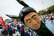 A man wears a monster suit of Shinzo Abe during the May Day rally in Tokyo on Monday, May 1, 2017, Thousands people participate demanding higher pays among other issues. 01/05/2017-Tokyo, JAPAN