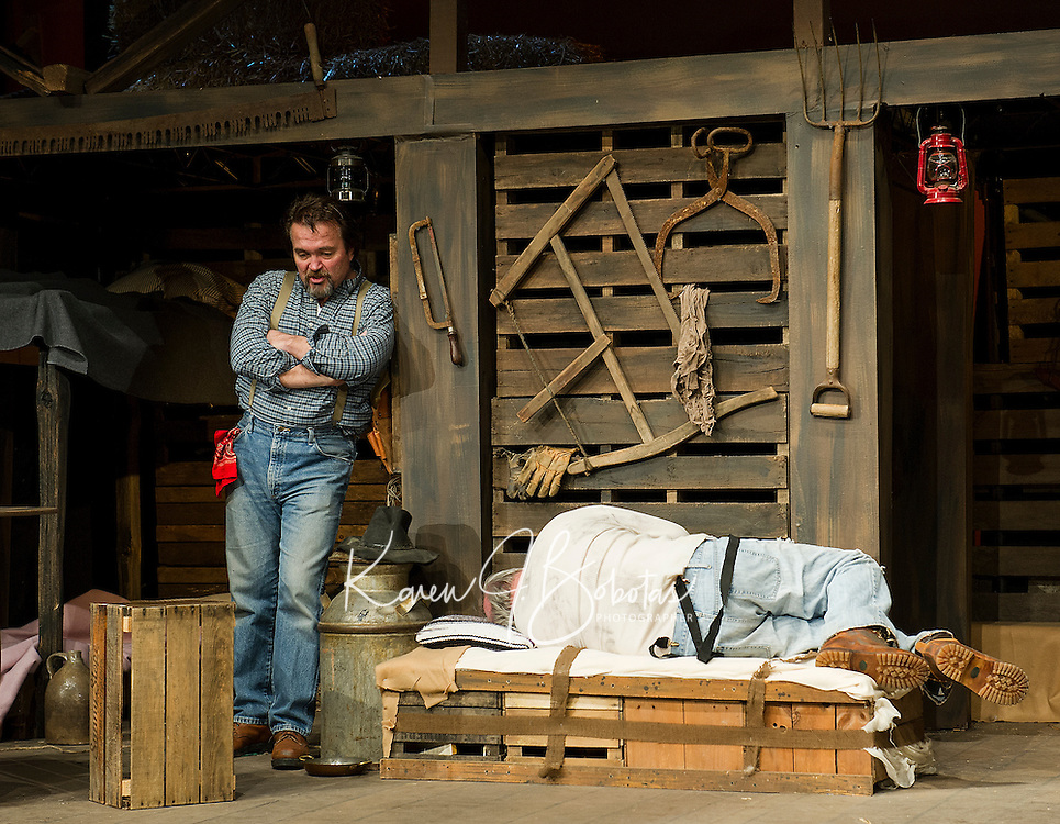 """Whit (Jim Rogato) and Candy (Ray Dudley) during dress rehearsal for """"Of Mice and Men"""" at the Winnipesaukee Playhouse Tuesday evening.  (Karen Bobotas/for the Laconia Daily Sun)"""