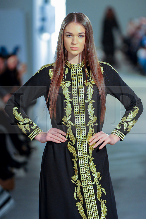 © Licensed to London News Pictures. 18/02/2017. London, UK.  A model presents a look by Rouge Couture (Dubai) at the UK's first London Modest Fashion Week taking place this weekend at the Saatchi Gallery.  The two day event sees 40 brands from across the world come together to showcase their collections for Muslim and other religious women. Photo credit : Stephen Chung/LNP
