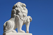 A statue of a lion guards the gates to a small park on St. George Street in St. Augustine, Florida