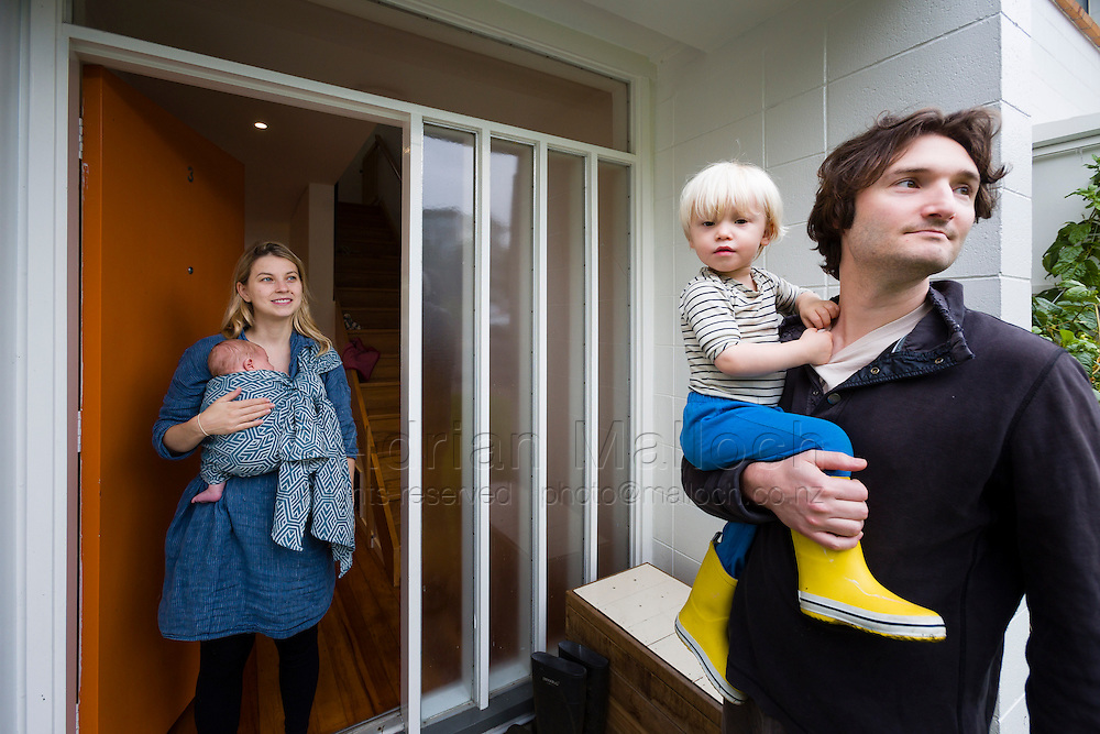 Beau and Emily Klaibert with their children Felix and Remy. The Ghetto. <br /> The Commune for Capitalists. The Arts Enclave. It feels like anyone who's every lived or worked centrally in Auckland knows someone who's lived here, in one of these 201 flats on the steep green flanks of Freemans Bay. Freemans Park is a convivial scatter of neat, terraced houses and three or four-storey apartment blocks, set in pretty park land.<br /> It attracts creative types: architects, designers, people working in media, and hospo. Several practicing artists live there now &ndash; but actually all sorts live there.<br /> Unusually, fully a quarter of the units are social housing; mostly Housing New Zealand-owned. The rest are either private rentalsor owner-occupied. Six-figure households live right by people on the benefit or minimum wage.<br /> &ndash; Excerpt from feature on Freemans Park by Nicola Shepheard<br /> Metro Magazine, June 2015