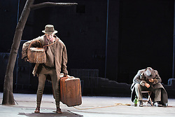"© Licensed to London News Pictures. 05/06/2015. London, UK. Luke Mullins as Lucky and Philip Quast as Pozzo. Actors Richard Roxburgh and Hugo Weaving star in Samuel Beckett's ""Waiting for Godot"" at the Barbican Theatre. Part of the International Beckett Season, this Sydney Theatre Company play is directed by Andrew Upton. With Luke Mullins as Luke, Philip Quast as Pozzo, Richard Roxburgh as Estragon and Hugo Weaving as Vladimir. Performances from 4 to 13 June 2015 at the Barbican Theatre. Photo credit : Bettina Strenske/LNP"