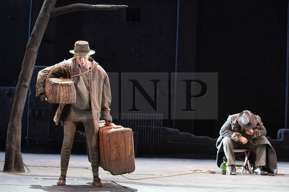 """© Licensed to London News Pictures. 05/06/2015. London, UK. Luke Mullins as Lucky and Philip Quast as Pozzo. Actors Richard Roxburgh and Hugo Weaving star in Samuel Beckett's """"Waiting for Godot"""" at the Barbican Theatre. Part of the International Beckett Season, this Sydney Theatre Company play is directed by Andrew Upton. With Luke Mullins as Luke, Philip Quast as Pozzo, Richard Roxburgh as Estragon and Hugo Weaving as Vladimir. Performances from 4 to 13 June 2015 at the Barbican Theatre. Photo credit : Bettina Strenske/LNP"""