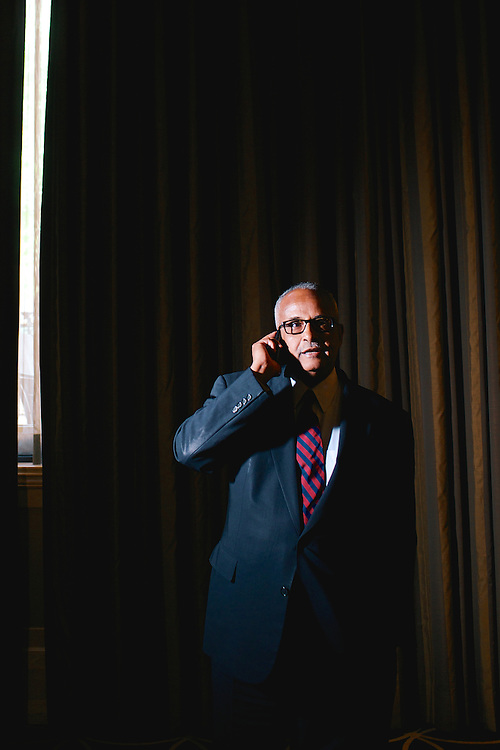 Dr. Abdusalam Omer, governor of the Central Bank of Somalia, takes a phone call from Mogadishu. .CREDIT: Lexey Swall for The Wall Street Journal.SOMALIA