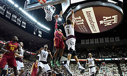 Iowa State's Monte Morris (11) shoots over Texas A&M's D.J Hogg (1) during the second half of an NCAA college basketball game, Saturday, Jan. 30, 2016, in College Station, Texas. Texas A&M won 72-62. (AP Photo/Sam Craft)