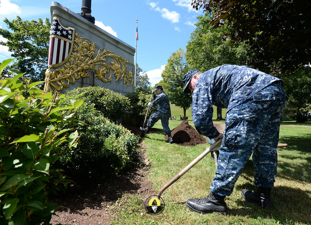 BANGOR Maine,  -- 8/8/15 -- Naval Aircrewman 1st Class Greg Jones of Winslow, Maine, right, and Air Traffic Controller 1st Class Eric Jennings of Bangor, Maine refurbish landscaping at the USS Maine (ACR 1) Memorial in downtown Bangor on Saturday. Five reservists from Navy Operational Support Center, Bangor, spent the afternoon spreading mulch around the memorial's pathways. USS Maine, an armored cruiser commissioned in 1895, sank in Havana harbor in 1898, just prior to the Spanish-American War. (U.S. Navy Photo by Chief Mass Communication Specialist Roger S. Duncan/ Released)