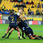 Beauden Barrett tackled by Liam Colman and Dillon Hunt during the super rugby union  game between Hurricanes  and Highlanders, played at Westpac Stadium, Wellington, New Zealand on 24 March 2018.  Hurricanes won 29-12.