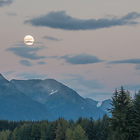 If you have been to Juneau at all you know that it rains in this area of Alaska, yes it is a rainforest. So on an evening where there were clear skies I headed out to photograph, and on this evening I ran into the full moon rising over the mountains. I quickly looked for a foreground element to add for this image and found a pair of floatplanes out at the Juneau International Airport to help frame the image on this September evening.