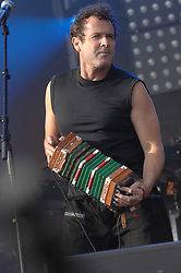 """File photo - Johnny Clegg performs live on stage during 'La Fete de l'Humanite', in La Courneuve, near Paris, France, on September 15, 2007. Clegg, has died at the age of 66, after a long battle with pancreatic cancer. Known as the """"white Zulu"""", he was a vocal critic of the apartheid government which ruled until 1994.<br /> The British-born musician, who uniquely blended western and Zulu music, was diagnosed with cancer in 2015. Photo by Lionel Moreau/ABACAPRESS.COM"""