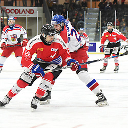 COBOURG, - Dec 18, 2015 -  WJAC Game 11- Team Czech Republic vs Team Switzerland at the 2015 World Junior A Challenge at the Cobourg Community Centre, ON. Philipp Kurashev #23 of Team Switzerland battles for control with Matyas Kantner #29 of Team Czech Republic during the first period.<br /> (Photo: Andy Corneau / OJHL Images)