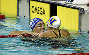 Jordyn Mahanga is spoken to by Rachel Ah Koy after winning the Womens 16 and over 100m Breaststroke Final on day four of the 2006 New Zealand Youth and Open Swimming Championships at QEII Leisure Centre, Christchurch on Saturday 15 April 2006. Photo: Simon Fergusson/PHOTOSPORT<br /> <br /> <br /> 150406