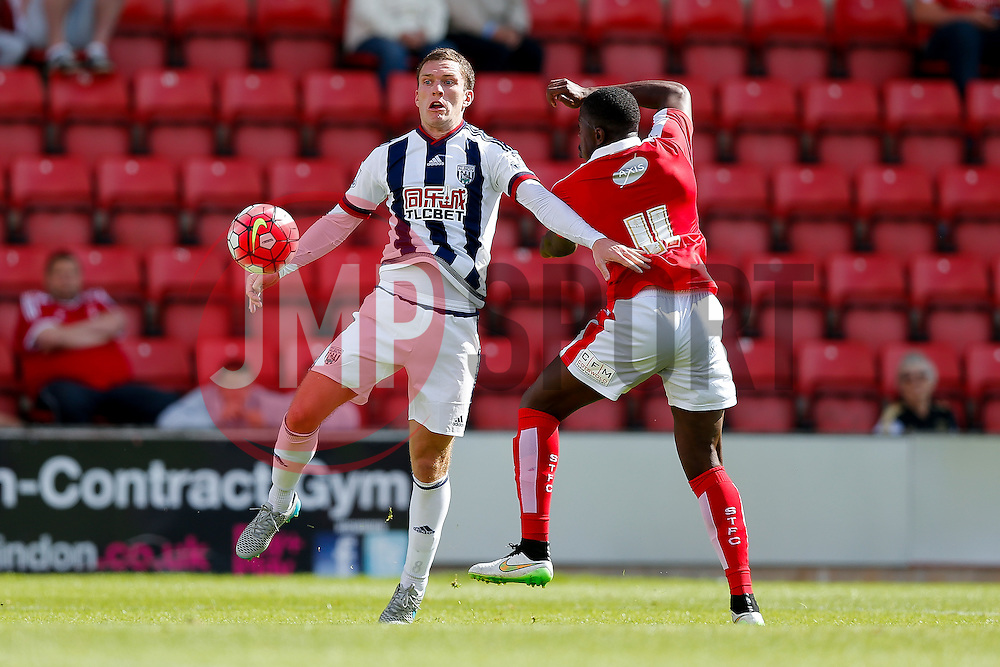 Craig Gardner of West Brom and John Ayina of Swindon Town - Mandatory byline: Rogan Thomson/JMP - 07966 386802 - 25/07/2015 - SPORT - Football - Swindon, England - The County Ground - Swindon Town v West Bromwich Albion - 2015/16 Pre Season Friendly.