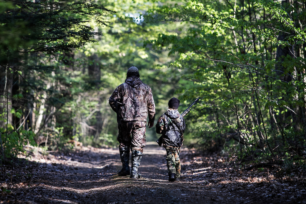 "Brett Ladeau, of Hartland, left, walks with his daughter Sydney Ladeau, 10, in New Hampshire during youth turkey opener on April 28, 2012.  Sydney said, ""I actually sort of like getting up early.  I'm excited, and I can't wait for the hunt. And I get to spend time with my dad."""