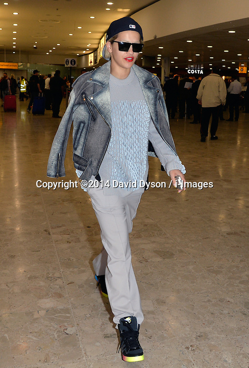 Rita Ora arrives at Heathrow Airport from Germany. Heathrow Airport, United Kingdom. Friday, 9th May 2014. Picture by David Dyson / i-Images