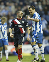 Photo: Aidan Ellis.<br /> Wigan Athletic v West Bromwich Albion. The Barclays Premiership. 15/01/2006.<br /> Wigan's Lee McCulloch argues with west Brom's Paul Robinson