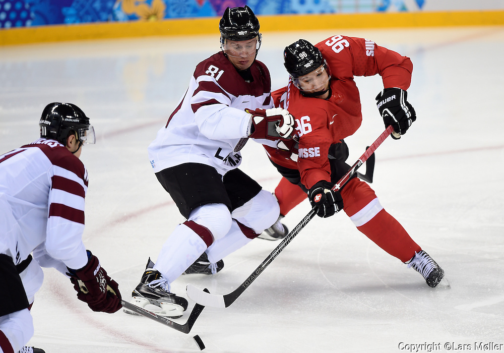 DK Caption: <br /> 20140212, Sochi, Rusland:  Vinter Olympiske Lege/Vinter OL i Sochi 2014: Isheckey herrer, Letland - Schweiz: Georgijs Pujacs, Letland, Latvia, Damien Brunner<br /> Foto: Lars M&oslash;ller<br /> UK Caption: <br /> 20140212, Sochi, Russia:  Sochi 2014 Winter Olympic Games: Icehockey Men, Latvia - Switzerland: Georgijs Pujacs, Letland, Latvia, Damien Brunner<br /> Photo: Lars Moeller