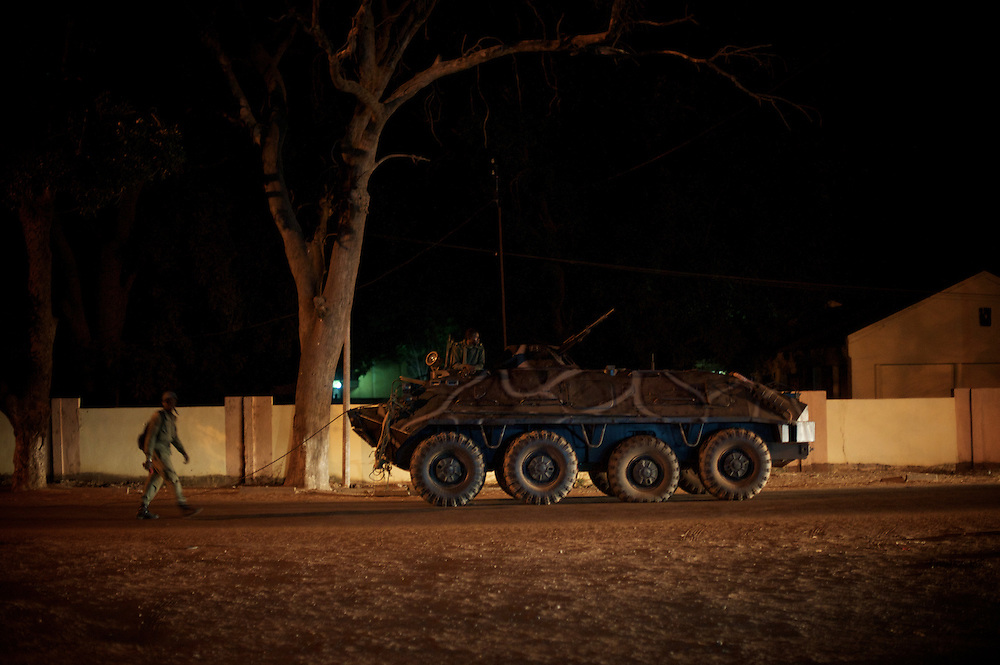 January 19, 2013 - Niono, Mali: Mali troops tow a broken Armoured Personal Carrier in central Niono. Niono is the last government controlled location before Diabaly, a city under islamist militants control since the 14th of January.<br /> <br /> Several insurgent groups have been fighting a campaign against the Malian government for independence or greater autonomy for northern Mali, an area known as Azawad. The National Movement for the Liberation of Azawad (MNLA), an organisation fighting to make Azawad an independent homeland for the Tuareg people, had taken control of the region by April 2012.<br /> <br /> The Malian government pledge to the French army to help the national troops to stop the rebellion advance towards the capital Bamako. The french troops started aerial attacks on rebel positions in the centre of the country and deployed several hundred special forces men to counter attack the advance on the ground. (Paulo Nunes dos Santos)