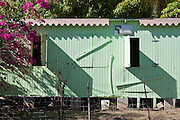shadow play on Island Ice House on Jost Van Dyke casts graphic forms and strong colors