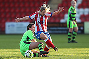 Forest Green Rovers Holly Timbrell(6) makes a tackle on Cheltenhams Louise Fensome during the Gloucestershire FA Trophy match between Cheltenham Town Ladies FC and Forest Green Rovers Ladies FC at LCI Rail Stadium, Cheltenham, England on 19 November 2017. Photo by Shane Healey.