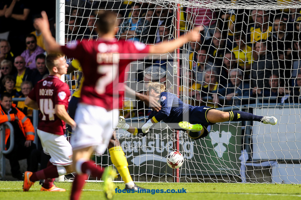 Sam Hoskins of Northampton Town (left) scores scores their first goal during the Sky Bet League 2 match at Sixfields Stadium, Northampton<br /> Picture by Andy Kearns/Focus Images Ltd 0781 864 4264<br /> 12/09/2015