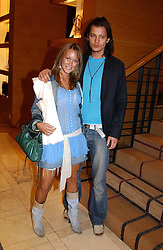 MISS ELLIE SHEPHERD and MR LEE CRAIG at a party hosted by Burberry to launch their special collection in aid of Breakthrough Breast Cancer, held at 21-23 New Bond Street, London W1 on 5th October 2004.<br /><br />NON EXCLUSIVE - WORLD RIGHTS