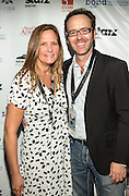 Guest and John Brister on the red carpet during opening night of the 25th Anniversary New Orleans Film Festival; Opening night film is 'Black and White' directed by Mike Binder