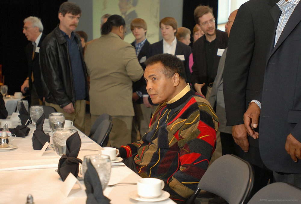 """Muhammad Ali is alone for a moment after being seated at the Muhammad Ali Center Sunday, March 18, 2007  in Louisville, Ky., for the Rumble Replay, a fundraiser showing the eight rounds of the Rumble In the Jungle Ali versus George Forman fight with comments by trainer Angelo Dundee, """"When We Were Kings"""" director Leon Gast and Photographer Howard Bingham. (AP Photo/Brian Bohannon).."""