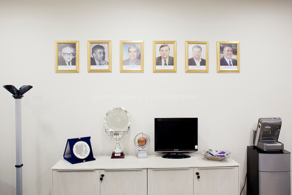 SAN MARINO, SAN MARNO - 3 OCTOBER 2011: Photographs of all the Presidents in the history of San Marino's national team are hanged in the Federation headquarters in San Marino, San Marino on October 3, 2011. The San Marino national football team is the last team in the FIFA  World Ranking (position 203). San Marino, whose population reaches 30,000 people, has never won a game since the team was founded in 1988. They have only ever won one game, beating Liechtenstein 1&ndash;0 in a friendly match on 28 April 2004. The Republic of San Marino, an enclave surronded by Italy situated on the eastern side of the Apennine Moutanins, is the oldest consitutional republic of the world<br /> <br /> <br /> ph. Gianni Cipriano