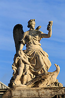 An angel statue at the first gate of the Chateau Versaille on the outskirts of Paris, France.