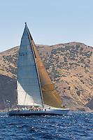 Sailboat near coast on ocean
