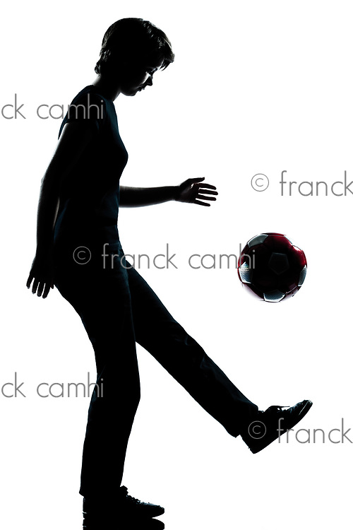 one caucasian young teenager silhouette  girl  juggling soccer football full length in studio cut out isolated on white background
