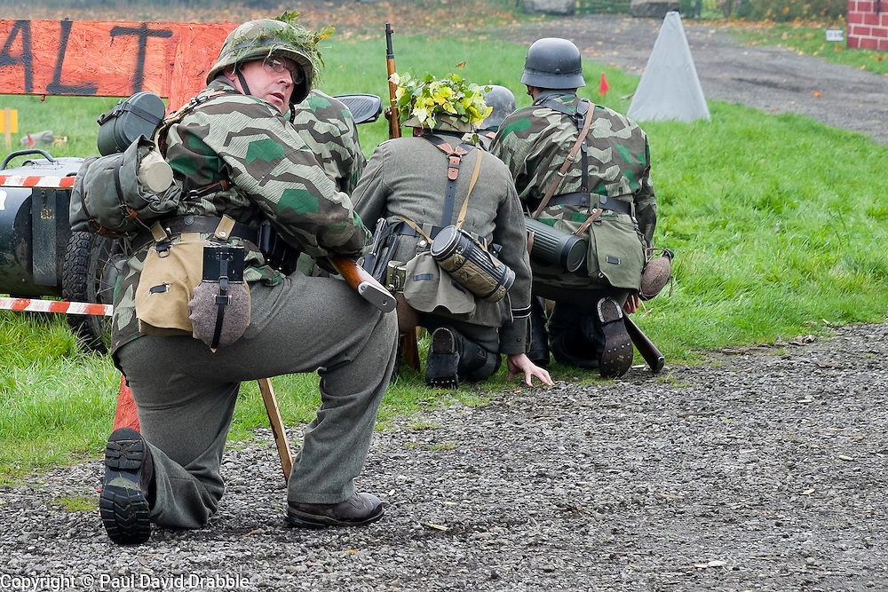 Re-enactors portrayiing a German panzergrenadiers from the Grossdeutschland Diviision during a battle battle re-enactment in on Pickering Showground<br /> <br /> 17/18 October 2015<br />  Image &copy; Paul David Drabble <br />  www.pauldaviddrabble.co.uk