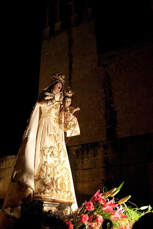North America, Mexico, Oaxaca Province, Oaxaca,night procession withan illuminated Virgin Mary on All Saints Day