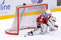 2019-12-11 | Umeå, Sweden:Close to 0-3 but Teg (30) Joakim Andersson saves that shot in HockeyEttan during the game  between Teg and Östersund at A3 Arena ( Photo by: Michael Lundström | Swe Press Photo )<br /> <br /> Keywords: Umeå, Hockey, HockeyEttan, A3 Arena, Teg, Östersund, mlto191211