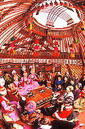 Musical performance with traditional folk instruments and costumes takes place in Yurt in the village of Shieli in the Qizilorda region, Kazakhstan.