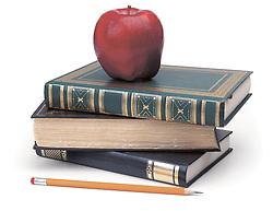 books, pencil & apple on white