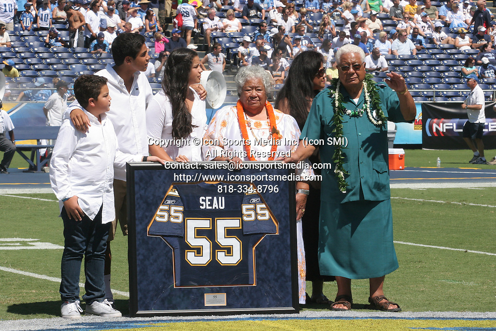 September 16, 2012; Junior Seau's family at the retirement of his son's #55 by the Chargers before the game.  The San Diego Chargers defeated the Tennessee Titans by the final score of 38-10 at Qualcomm Stadium in San Diego, CA.