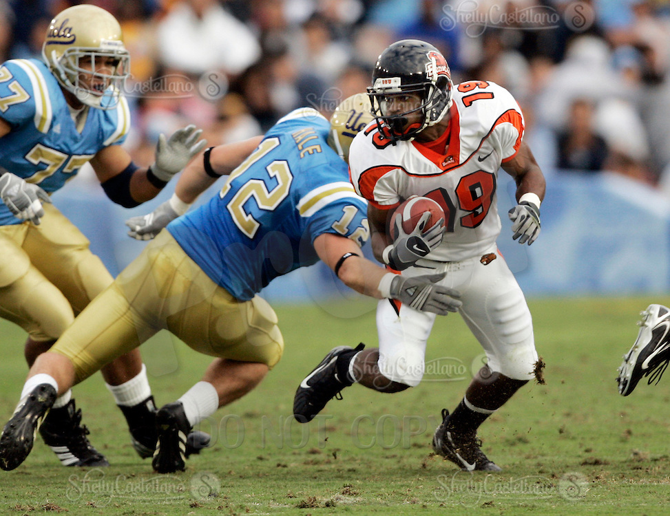 11 November 2006:  #12 John Hale grabs #19 Sammie Stroughter in the crotch during the UCLA Bruins 25-7 win over the Oregon State Beavers Pac-10 college football game at the Rose Bowl.<br />