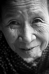Portrait of an old vietnamese woman in Hoi An, Vietnam, Asia. Portrait d'une vietnamienne agée.